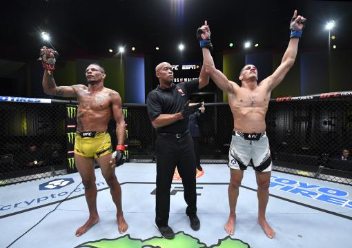 Niko Price celebrates his victory over Alex Oliveira of Brazil in their welterweight bout during the UFC Fight Night event at UFC APEX on October 02 2021 in Las Vegas Nevada. (Photo by Jeff Bottari/Zuffa LLC)