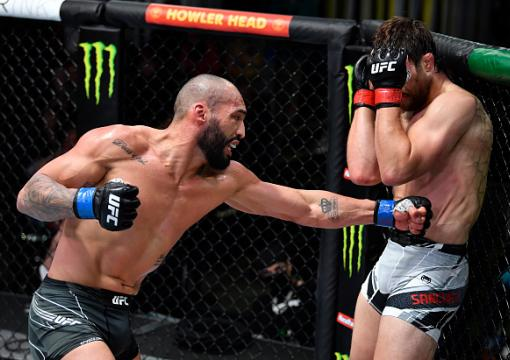 Bruno Silva of Brazil punches Andrew Sanchez in a middleweight fight during the UFC Fight Night event at UFC APEX on October 16 2021 in Las Vegas Nevada. (Photo by Chris Unger/Zuffa LLC)