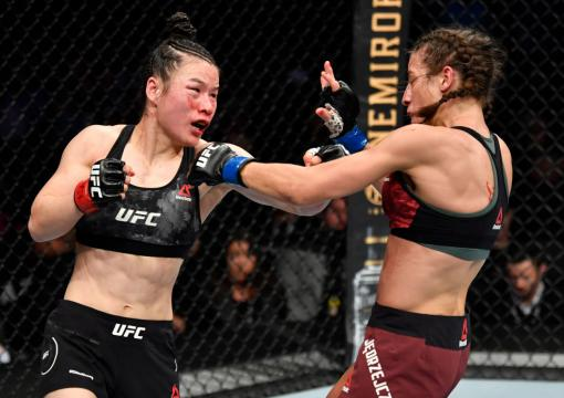 LAS VEGAS, NEVADA - MARCH 07: (L-R) Zhang Weili of China punches Joanna Jedrzejczyk of Poland in their UFC strawweight championship fight during the UFC 248