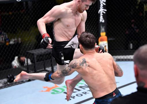 Cory Sandhagen lands a flying knee to knock out Frankie Edgar in their bantamweight fight during the UFC Fight Night event at UFC APEX on February 06, 2021 in Las Vegas, Nevada. (Photo by Chris Unger/Zuffa LLC)