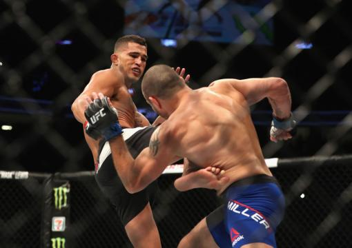 LAS VEGAS, NV - JULY 08:  (L-R) Anthony Pettis kicks Jim Miller in their lightweight bout during the UFC 213 event at T-Mobile Arena on July 8, 2017 in Las Vegas, Nevada.  (Photo by Christian Petersen/Zuffa LLC)