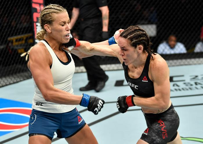 CALGARY, AB - JULY 28:  (R-L) Alexis Davis of Canada punches Katlyn Chookagian in their women's flyweight bout during the UFC Fight Night event at Scotiabank Saddledome on July 28, 2018 in Calgary, Alberta, Canada. (Photo by Jeff Bottari/Zuffa LLC via Getty Images)
