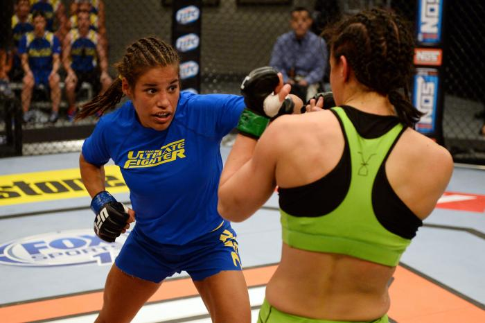 LAS VEGAS, NV - JUNE 6:  (L-R) Julianna Pena punches Shayna Baszler in their preliminary fight during filming of season eighteen of The Ultimate Fighter on June 6, 2013 in Las Vegas, Nevada. (Photo by Al Powers/Zuffa LLC via Getty Images)