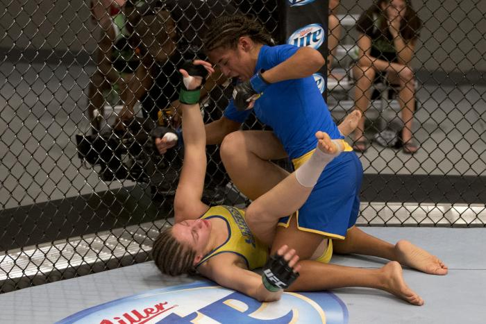 LAS VEGAS, NV - JULY 02:  (R-L) Julianna Pena punches Sarah Moras in their semifinal fight during filming of season eighteen of The Ultimate Fighter on July 2, 2013 in Las Vegas, Nevada. (Photo by Josh Hedges/Zuffa LLC via Getty Images)
