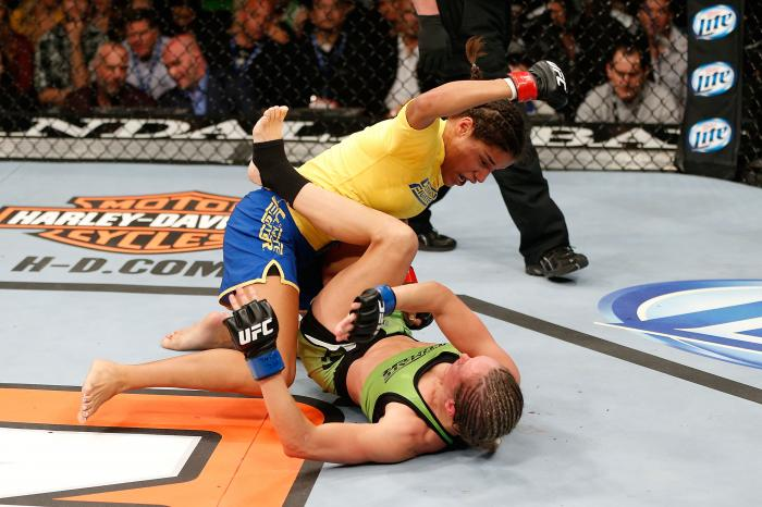 LAS VEGAS, NV - NOVEMBER 30:  (L-R) Julianna Pena punches Jessica Rakoczy in their women's bantamweight final fight during The Ultimate Fighter season 18 live finale inside the Mandalay Bay Events Center on November 30, 2013 in Las Vegas, Nevada. (Photo by Josh Hedges/Zuffa LLC via Getty Images)