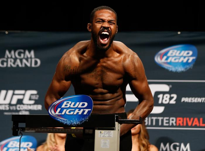 "LAS VEGAS, NV - JANUARY 02:  UFC light heavyweight champion Jon ""Bones"" Jones poses on the scale after weighing in during the UFC 182 weigh-in event at the MGM Grand Conference Center on January 2, 2015 in Las Vegas, Nevada. (Photo by Josh Hedges/Zuffa LLC via Getty Images)"