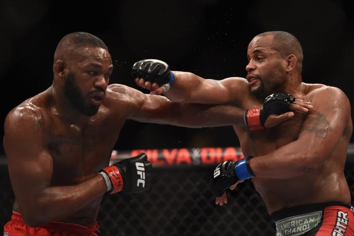 Jon Jones punches Daniel Cormier in their UFC light heavyweight championship bout during the UFC 182 event at the MGM Grand Garden Arena on January 3, 2015 in Las Vegas, Nevada.