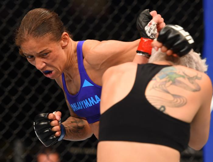DALLAS, TX - MARCH 14:  (L-R) Germaine de Randamie lands a punch to the chin of Larissa Pacheco in their women's bantamweight bout during the UFC 185 event at the American Airlines Center on March 14, 2015 in Dallas, Texas. (Photo by Josh Hedges/Zuffa LLC via Getty Images)