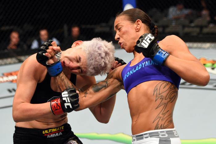 DALLAS, TX - MARCH 14:  (R-L) Germaine de Randamie lands a punch to the chin of Larissa Pacheco in their women's bantamweight bout during the UFC 185 event at the American Airlines Center on March 14, 2015 in Dallas, Texas. (Photo by Josh Hedges/Zuffa LLC via Getty Images)