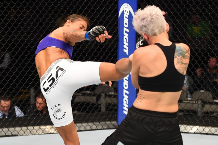DALLAS, TX - MARCH 14:  (L-R) Germaine de Randamie lands a kick to the arm of Larissa Pacheco in their women's bantamweight bout during the UFC 185 event at the American Airlines Center on March 14, 2015 in Dallas, Texas. (Photo by Josh Hedges/Zuffa LLC via Getty Images)