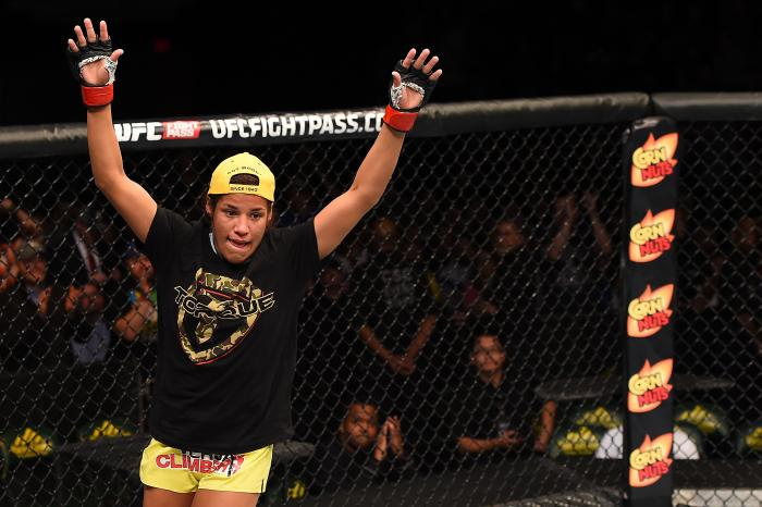 FAIRFAX, VA - APRIL 04:  Juliana Pena celebrates after defeating Milana Dudieva in their women's bantamweight fight during the UFC Fight Night event at the Patriot Center on April 4, 2015 in Fairfax, Virginia. (Photo by Josh Hedges/Zuffa LLC via Getty Images)