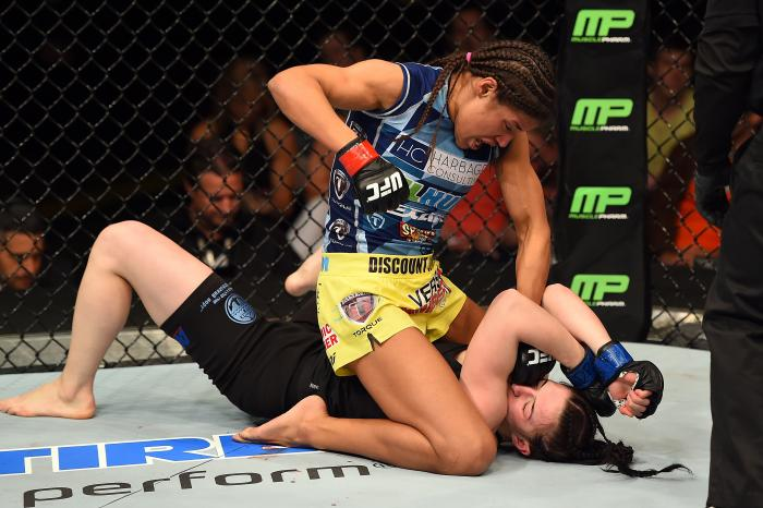 FAIRFAX, VA - APRIL 04:  (L-R) Juliana Pena punches Milana Dudieva on the ground in their women's bantamweight fight during the UFC Fight Night event at the Patriot Center on April 4, 2015 in Fairfax, Virginia. (Photo by Josh Hedges/Zuffa LLC via Getty Images)