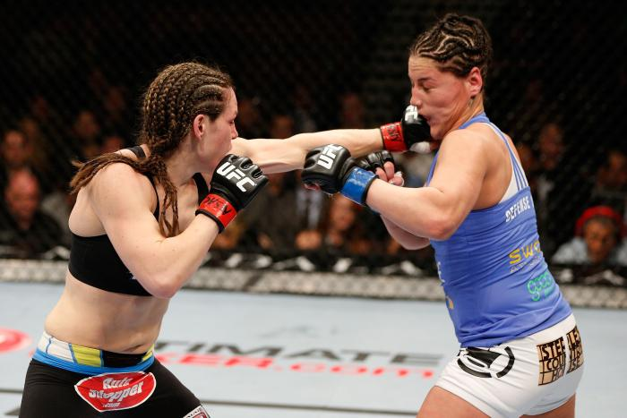 LAS VEGAS, NV - FEBRUARY 22:  (L-R) Alexis Davis punches Jessica Eye in their women's bantamweight bout during UFC 170 inside the Mandalay Bay Events Center on February 22, 2014 in Las Vegas, Nevada. (Photo by Josh Hedges/Zuffa LLC via Getty Images)