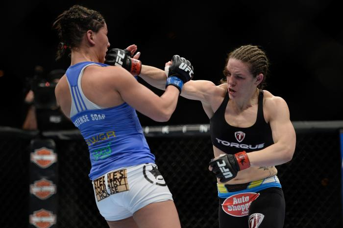 LAS VEGAS, NV - FEBRUARY 22:  (R-L) Alexis Davis punches Jessica Eye in their women's bantamweight bout during UFC 170 inside the Mandalay Bay Events Center on February 22, 2014 in Las Vegas, Nevada. (Photo by Jeff Bottari/Zuffa LLC via Getty Images)