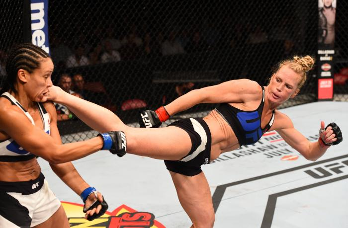 SAN DIEGO, CA - JULY 15:   (R-L) Holly Holm kicks Marion Reneau in their women's bantamweight bout during the UFC event at the Valley View Casino Center on July 15, 2015 in San Diego, California. (Photo by Jeff Bottari/Zuffa LLC via Getty Images)