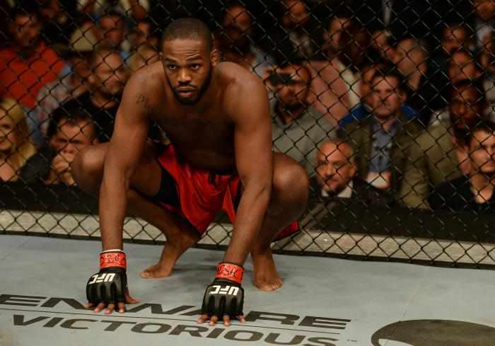 "BALTIMORE, MD - APRIL 26: Jon ""Bones"" Jones crouches in the Octagon before his light heavyweight championship bout against Glover Teixeira during the UFC 172 event at the Baltimore Arena on April 26, 2014 in Baltimore, Maryland. (Photo by Patrick Smith/Zuffa LLC via Getty Images)"