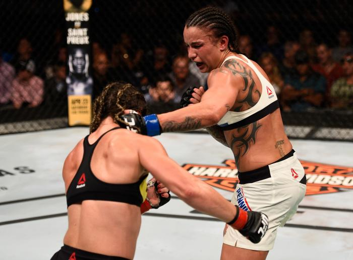 TAMPA, FL - APRIL 16:   (R-L) Raquel Pennington punches Bethe Correira in their women's bantamweight bout during the UFC Fight Night event at Amalie Arena on April 16, 2016 in Tampa, Florida. (Photo by Jeff Bottari/Zuffa LLC via Getty Images)