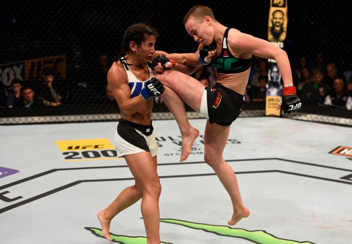 TAMPA, FL - APRIL 16:  (R-L) Rose Namajunas knees Tecia Torres in their women's strawweight bout during the UFC Fight Night event at Amalie Arena on April 16, 2016 in Tampa, Florida. (Photo by Jeff Bottari/Zuffa LLC via Getty Images)