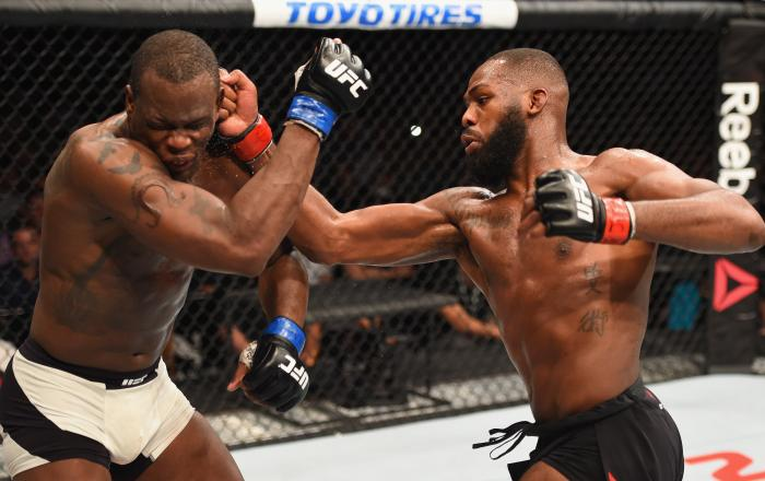 Jon Jones punches Ovince Saint Preux in their interim UFC light heavyweight championship bout during the UFC 197 event inside MGM Grand Garden Arena on April 23, 2016 in Las Vegas, Nevada.
