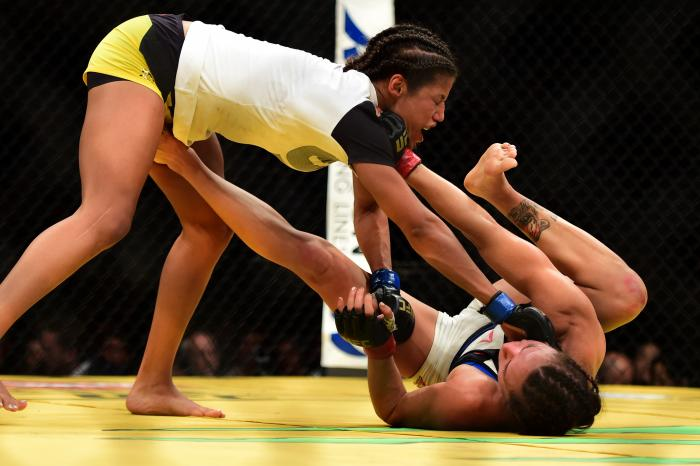 Julianna Pena fights Cat Zigano in their women's bantamweight bout during the UFC 200 event on July 9, 2016 at T-Mobile Arena in Las Vegas, Nevada.