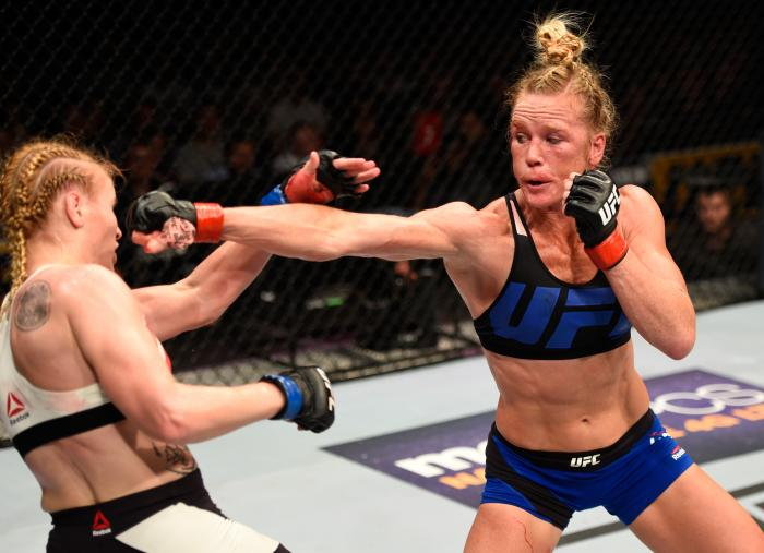 CHICAGO, IL - JULY 23:  (R-L) Holly Holm punches Valentina Shevchenko of Kyrgyzstan in their women's bantamweight bout during the UFC Fight Night event at the United Center on July 23, 2016 in Chicago, Illinois. (Photo by Josh Hedges/Zuffa LLC via Getty Images)