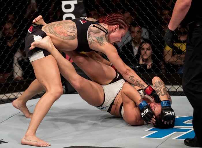 BRASILIA, BRAZIL - SEPTEMBER 24: Cris Cyborg of Brazil submits Lina Lansberg of Sweden in their catchweight bout during the UFC Fight Night event at Nilson Nelson gymnasium on September 24, 2016 in Brasilia, Brazil. (Photo by Buda Mendes/Zuffa LLC via Getty Images)
