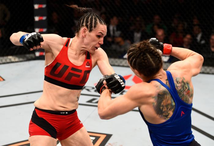 LAS VEGAS, NV - DECEMBER 03:  (L-R) Alexis Davis of Canada punches Sara McMann in their bantamweight bout during The Ultimate Fighter Finale event inside the Pearl concert theater at the Palms Resort & Casino on December 3, 2016 in Las Vegas, Nevada. (Photo by Jeff Bottari/Zuffa LLC via Getty Images)