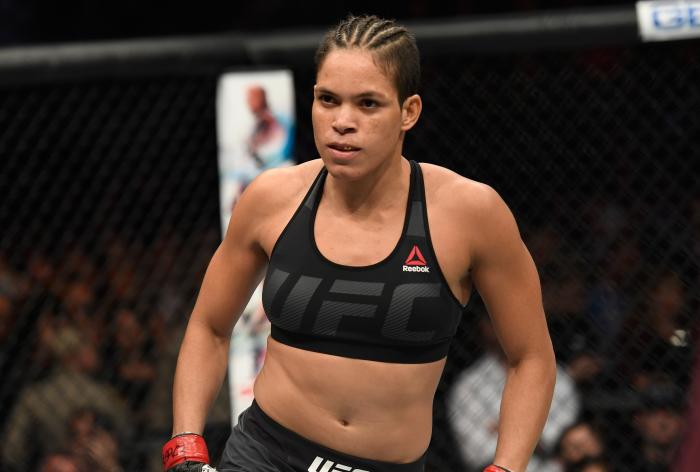 Amanda Nunes looks to the crowd in her UFC women's bantamweight championship bout during the UFC 207 event at T-Mobile Arena on December 30, 2016 in Las Vegas, Nevada.