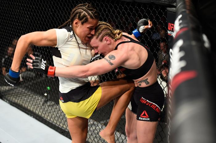 DENVER, CO - JANUARY 28:  (L-R) Julianna Pena knees Valentina Shevchenko of Kyrgyzstan in their women's bantamweight bout during the UFC Fight Night event at the Pepsi Center on January 28, 2017 in Denver, Colorado. (Photo by Josh Hedges/Zuffa LLC via Getty Images)