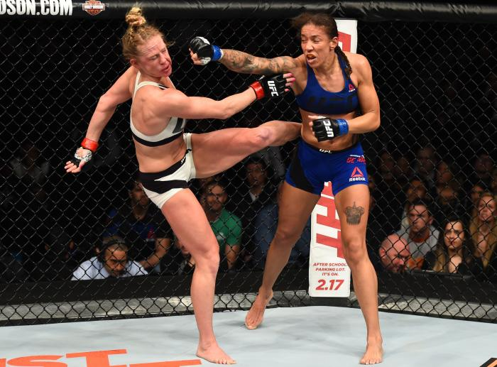 BROOKLYN, NEW YORK - FEBRUARY 11:  (R-L) Germaine de Randamie of The Netherlands punches Holly Holm in their women's featherweight championship bout during the UFC 208 event inside Barclays Center on February 11, 2017 in Brooklyn, New York. (Photo by Jeff Bottari/Zuffa LLC via Getty Images)