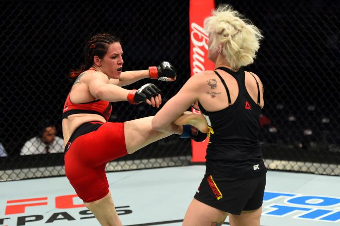 NASHVILLE, TN - APRIL 22:  (L-R) Alexis Davis kicks Cindy Dandois of Belgium in their women's bantamweight bout during the UFC Fight Night event at Bridgestone Arena on April 22, 2017 in Nashville, Tennessee. (Photo by Jeff Bottari/Zuffa LLC via Getty Images)