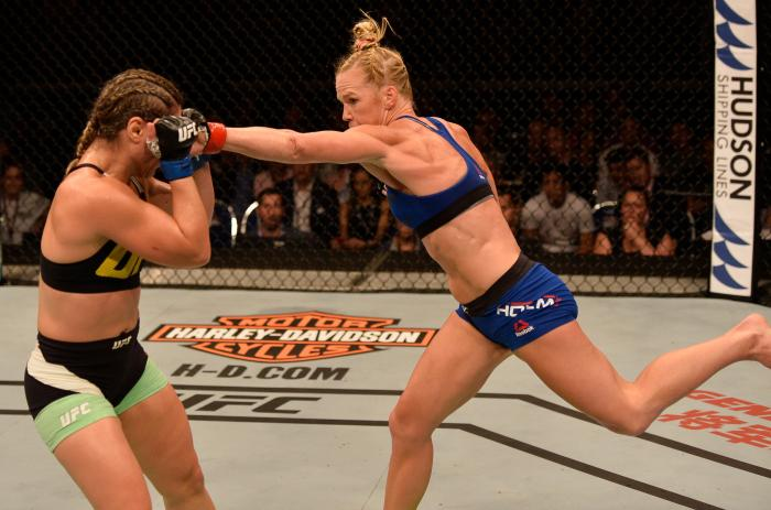 SINGAPORE - JUNE 17:   (R-L) Holly Holm punches Bethe Correia of Brazil in their women's bantamweight bout during the UFC Fight Night event at the Singapore Indoor Stadium on June 17, 2017 in Singapore. (Photo by Brandon Magnus/Zuffa LLC via Getty Images)