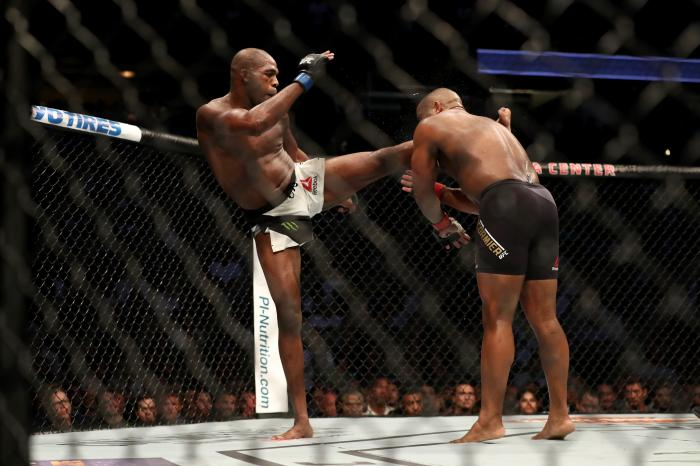 Jon jones kicks Daniel Cormier in their UFC light heavyweight championship bout during the UFC 214 event at Honda Center on July 29, 2017 in Anaheim, California.