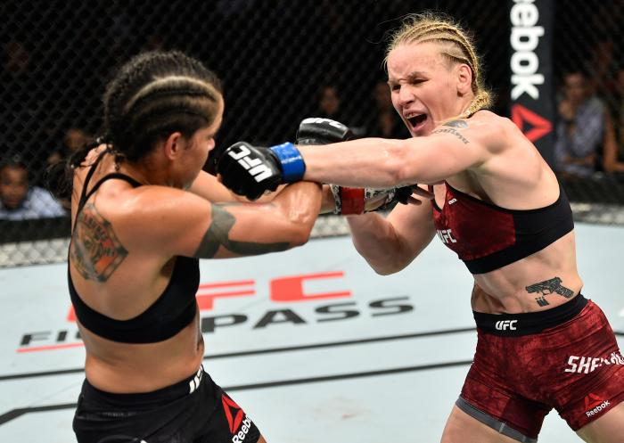EDMONTON, AB - SEPTEMBER 09:  (R-L) Valentina Shevchenko of Kyrgyzstan punches Amanda Nunes of Brazil in their women's bantamweight bout during the UFC 215 event inside the Rogers Place on September 9, 2017 in Edmonton, Alberta, Canada. (Photo by Jeff Bottari/Zuffa LLC via Getty Images)