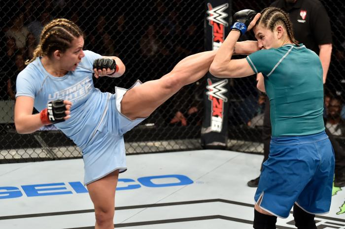 LAS VEGAS, NV - DECEMBER 01:  (L-R) Nicco Montano kicks Roxanne Modafferi in their women's flyweight championship bout during the TUF Finale event inside Park Theater on December 01, 2017 in Las Vegas, Nevada. (Photo by Jeff Bottari/Zuffa LLC via Getty Images)