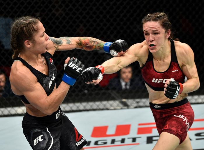 FRESNO, CA - DECEMBER 09:  (R-L) Alexis Davis of Canada punches Liz Carmouche in their women's flyweight bout during the UFC Fight Night event inside Save Mart Center on December 9, 2017 in Fresno, California. (Photo by Jeff Bottari/Zuffa LLC via Getty Images)
