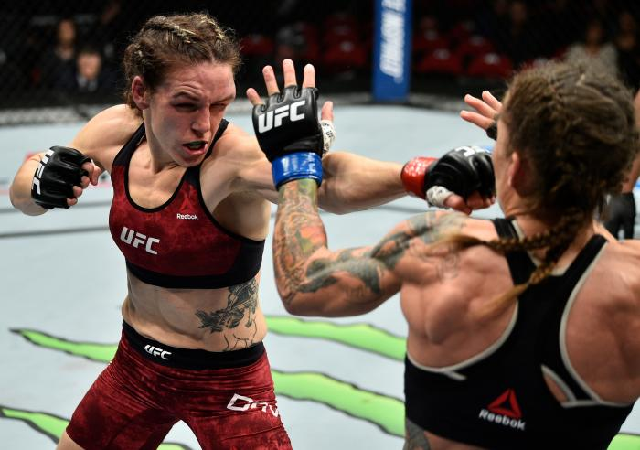 FRESNO, CA - DECEMBER 09:  (L-R) Alexis Davis of Canada punches Liz Carmouche in their women's flyweight bout during the UFC Fight Night event inside Save Mart Center on December 9, 2017 in Fresno, California. (Photo by Jeff Bottari/Zuffa LLC via Getty Images)