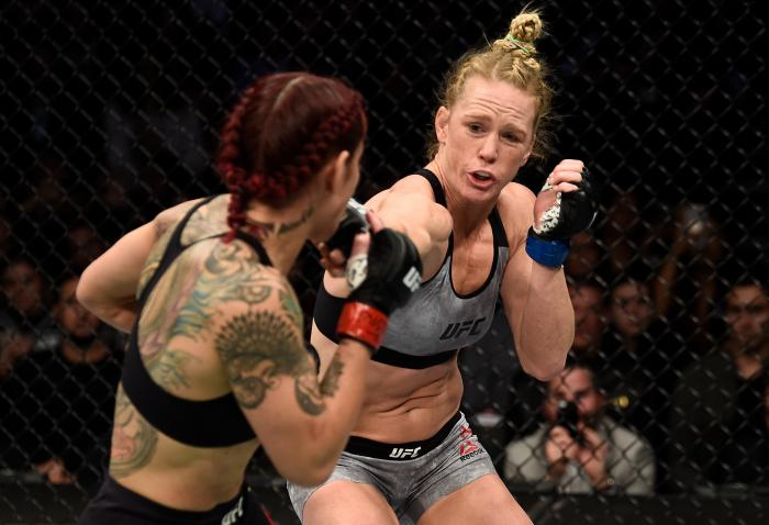 LAS VEGAS, NV - DECEMBER 30:  (R-L) Holly Holm punches Cris Cyborg of Brazil in their women's featherweight bout during the UFC 219 event inside T-Mobile Arena on December 30, 2017 in Las Vegas, Nevada. (Photo by Jeff Bottari/Zuffa LLC via Getty Images)