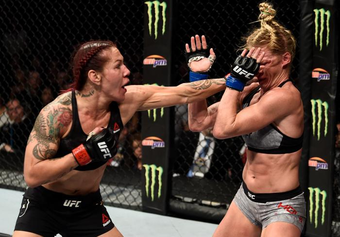LAS VEGAS, NV - DECEMBER 30:  (L-R) Cris Cyborg of Brazil punches Holly Holm in their women's featherweight bout during the UFC 219 event inside T-Mobile Arena on December 30, 2017 in Las Vegas, Nevada. (Photo by Jeff Bottari/Zuffa LLC via Getty Images)