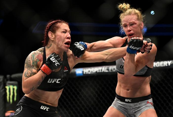 LAS VEGAS, NV - DECEMBER 30:  (L-R) Cris Cyborg of Brazil and Holly Holm trade punches in their women's featherweight bout during the UFC 219 event inside T-Mobile Arena on December 30, 2017 in Las Vegas, Nevada. (Photo by Brandon Magnus/Zuffa LLC via Getty Images)