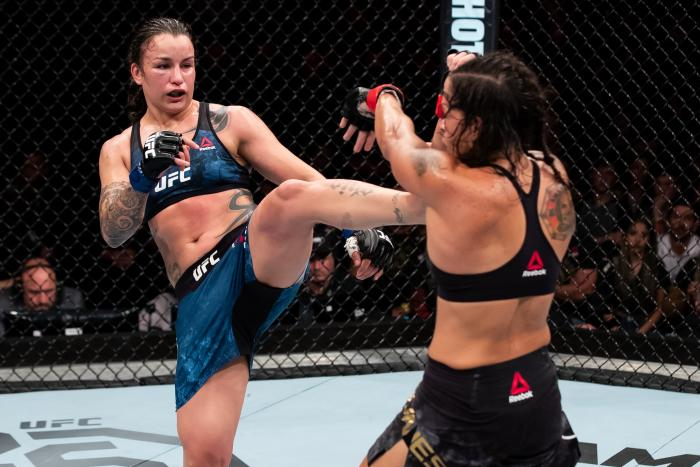 RIO DE JANEIRO, BRAZIL - MAY 12: Raquel Pennington ( L) of the United States kicks Amanda Nunes of Brazil in their women's bantamweight bout during the UFC 224 event at Jeunesse Arena on May 12, 2018 in Rio de Janeiro, Brazil. (Photo by Buda Mendes/Zuffa LLC)