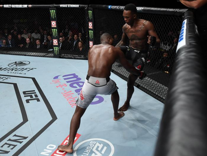 NEW YORK, NY - NOVEMBER 03:  (R-L) Israel Adesanya of Nigeria knees Derek Brunson in their middleweight bout during the UFC 230 event inside Madison Square Garden on November 3, 2018 in New York, New York. (Photo by Jeff Bottari/Zuffa LLC via Getty Images)