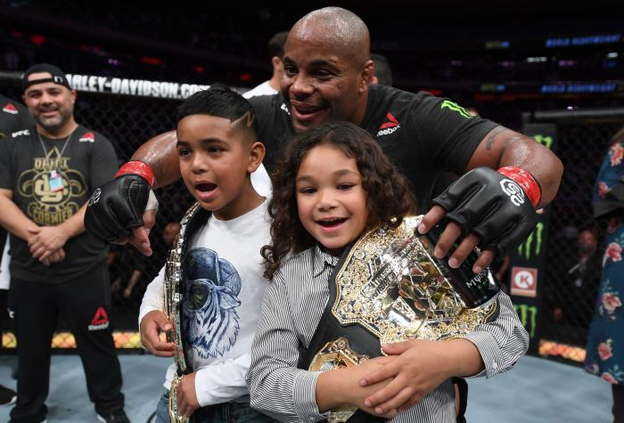 NEW YORK, NY - NOVEMBER 03:  Daniel Cormier celebrates with his kids after his submission victory over Derrick Lewis in their UFC heavyweight championship bout during the UFC 230 event inside Madison Square Garden on November 3, 2018 in New York, New York. (Photo by Jeff Bottari/Zuffa LLC via Getty Images)