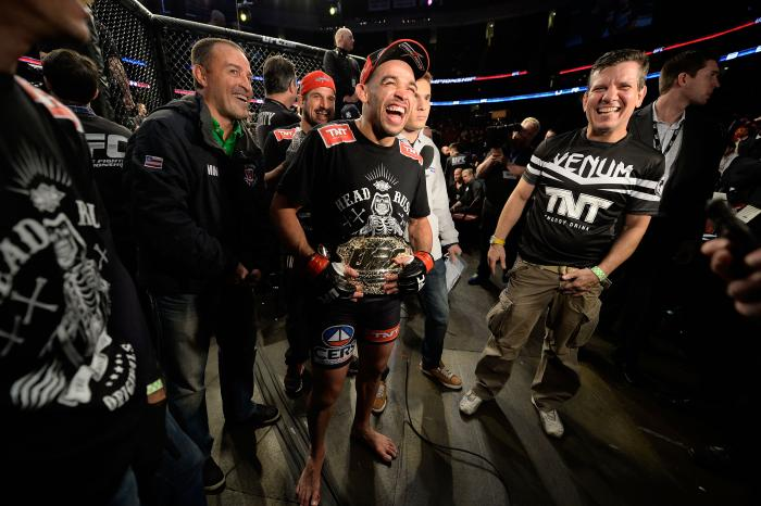 NEWARK, NJ - FEBRUARY 1:  Renan Barao celebrates with his corner after defeating Uriah Faber by KO in their bantamweight championship fight during the UFC 169 event at the Prudential Center on February 1, 2014 in Newark, New Jersey. (Photo by Jeff Bottari/Zuffa LLC/Zuffa LLC via Getty Images)