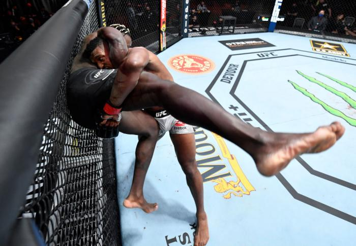 Alonzo Menifield takes down Fabio Cherant in their light heavyweight fight during the UFC 260 event at UFC APEX on March 27, 2021 in Las Vegas, Nevada. (Photo by Jeff Bottari/Zuffa LLC)