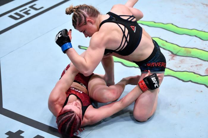 Miranda Maverick punches Gillian Robertson of Canada in their lightweight fight during the UFC 260 event at UFC APEX on March 27, 2021 in Las Vegas, Nevada. (Photo by Jeff Bottari/Zuffa LLC)