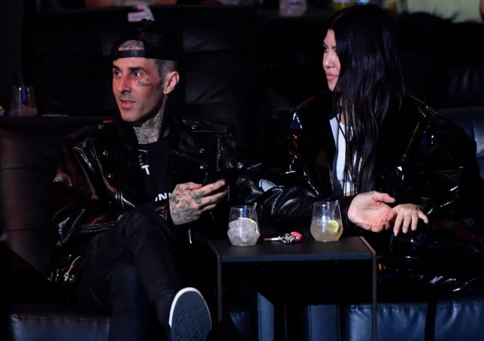 Travis Barker and Kourtney Kardashian are seen in attendance during the UFC 260 event at UFC APEX on March 27, 2021 in Las Vegas, Nevada. (Photo by Jeff Bottari/Zuffa LLC)
