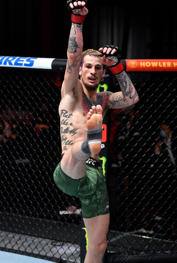 Sean O'Malley reacts after his knockout victory over Thomas Almeida of Brazil in their bantamweight fight during the UFC 260 event at UFC APEX on March 27, 2021 in Las Vegas, Nevada. (Photo by Jeff Bottari/Zuffa LLC)