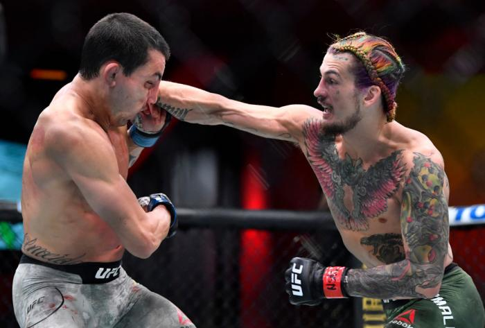 Sean O'Malley punches Thomas Almeida of Brazil in their bantamweight fight during the UFC 260 event at UFC APEX on March 27, 2021 in Las Vegas, Nevada. (Photo by Chris Unger/Zuffa LLC)