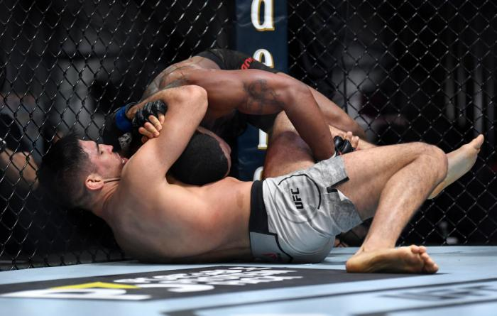 Vicente Luque secures a submission against Tyron Woodley in their welterweight fight during the UFC 260 event at UFC APEX on March 27, 2021 in Las Vegas, Nevada. (Photo by Chris Unger/Zuffa LLC)